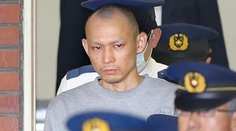 山本泰雄被捕後的相片