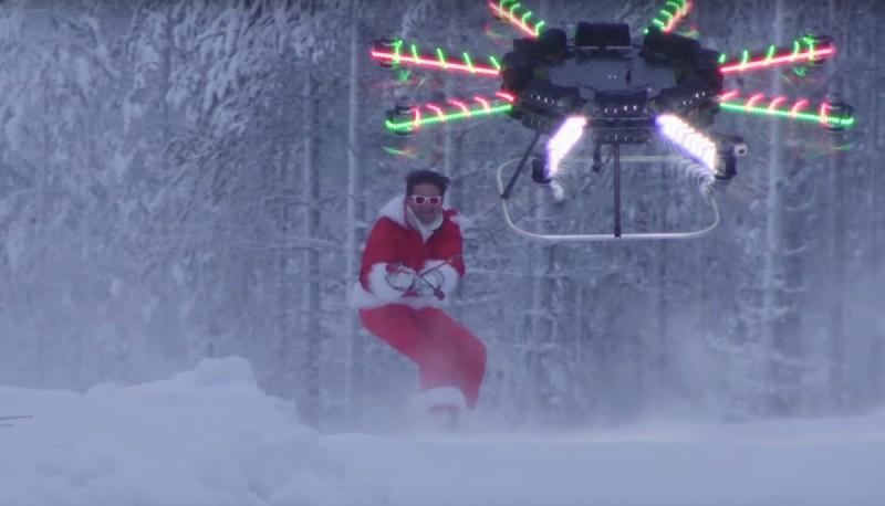 無人機拉動 Casey Neistat  在雪山上滑行。